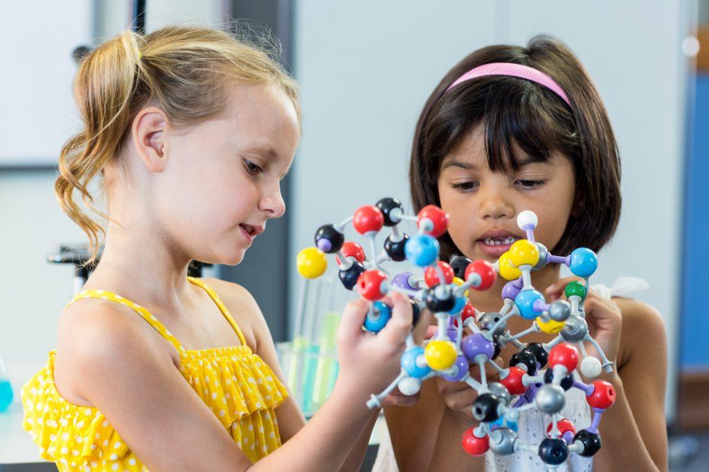 Girls holding DNA model